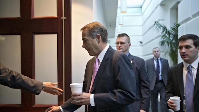 """House Speaker John Boehner of Ohio heads into a closed-door strategy session with GOP members, on Capitol Hill in Washington, Friday, Jan. 4, 2013, at the start of the first full day of business for the new 113th Congress. Yesterday, Boehner survived a suspenseful roll call vote for his speakership as some conservatives opposed his recent dealings over the """"fiscal cliff"""" negotiations. The House plans to hold it's first vote on a Superstorm Sandy aid package today after a delay prompted Republican recriminations against the leadership. (AP Photo/J. Scott Applewhite)"""