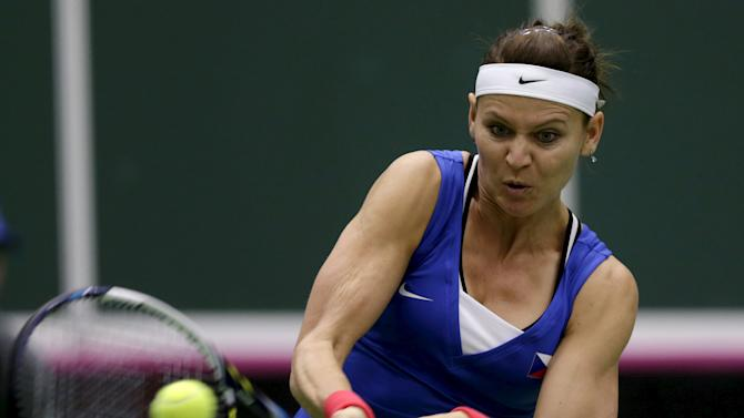 Czech Republic's Lucie Safarova returns a ball to France's Caroline Garcia during their semi-final match of the Fed Cup tennis tournament in Ostrava