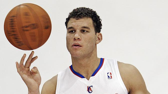 Los Angeles Clippers forward Blake Griffin poses for a photo during NBA basketball media day in Los Angeles, Tuesday, Dec. 13, 2011. (AP Photo/Reed Saxon)