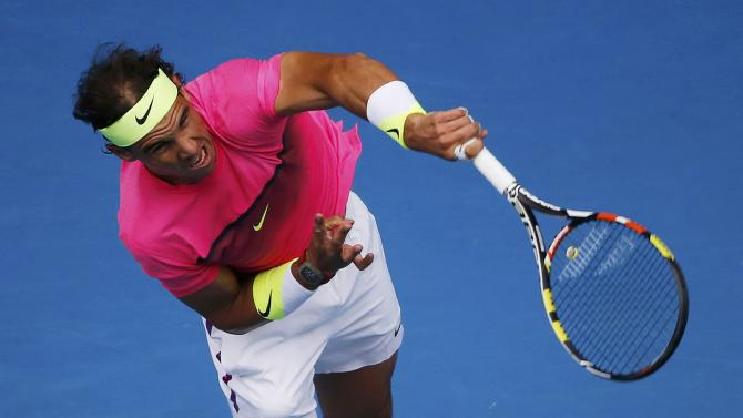 Nadal of Spain serves to Berdych of the Czech Republic during their men's singles quarter-final match at the Australian Open 2015 tennis tournament in Melbourne