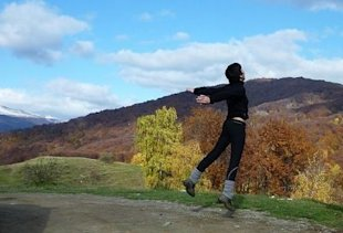 autumn landscape woman jumping