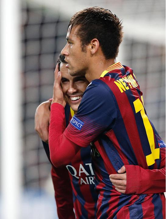 Barcelona's Pedro Rodriguez, left, celebrates with teammate  Neymar after scouring their second goal during a Group H Champions League soccer match between FC Barcelona and Celtic FC at the Camp N