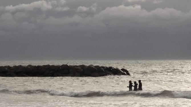 "Members of a group of ""sea-walkers"" called Chtis Pingouins take a morning walk in Valras-Plage"