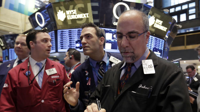 John Liotti, right, works with fellow traders on the floor of the New York Stock Exchange Thursday, Dec. 20, 2012.  Another failed attempt find a compromise in U.S. budget negotiations sent world stock markets plummeting Friday, Dec. 21, 2012 as investors feared the world's largest economy could teeter into recession if no deal is found. (AP Photo/Richard Drew)
