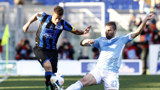 Atalanta forward German Gustavo Denis, of Argentina, left, is tackled by Lazio defender Lorik Cana, of Kosovo, during a Serie A soccer match between Lazio and Atalanta, at Rome's Olympic stadium, Sunday, March 9, 2014