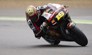 Spanish rider Alvaro Bautista rides his San Carlo Honda MotoGP bike during the final qualifying session at the British Grand Prix at Silverstone racetrack near Northampton, central England. Bautista qualified in first position for Sunday's race