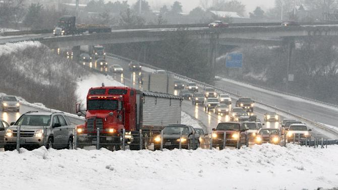 Traffic move slowly along the northbound Interstate 35 after the Interstate 29 split, Monday, Feb. 25, 2013, in Kansas City, Mo. (AP Photo/The Kansas City Star, Keith Myers)