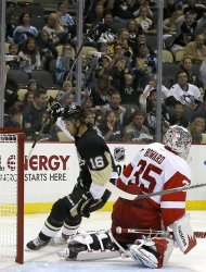 Pittsburgh Penguins' Brandon Sutter (16) celebrates after scoring past Detroit Red Wings goalie Jimmy Howard (35) in the second period of an NHL preseason hockey game, Monday, Sept. 16, 2013, in Pittsburgh. (AP Photo/Keith Srakocic)