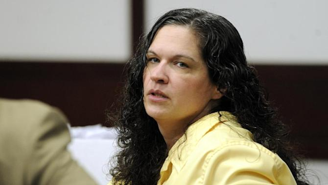 """Defendant Dorice """"Dee Dee"""" Moore arrives in court at the Hillsborough County Courthouse for the opening statements in her case Wednesday, Nov. 28, 2012 in Tampa, Fla. Moore is charged with the murder of Florida Lottery winner Abraham Shakespeare. (AP Photo/The Tampa Tribune, Jay Conner, Pool)"""