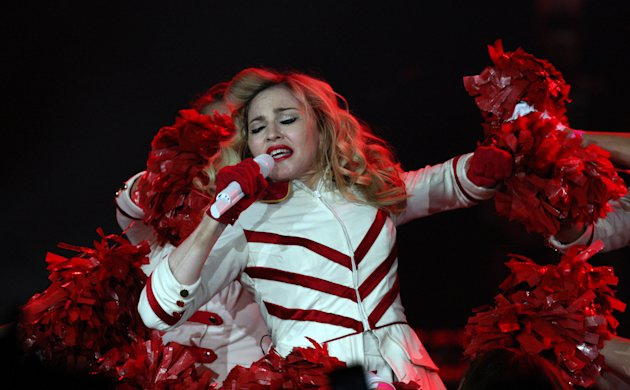 FILE - U.S. singer Madonna performs during her concert at concert Hall in St. Petersburg, Russia, in this Thursday, Aug. 9, 2012 file photo. A Russian court has dismissed a lawsuit that sought millions of dollars in damages from Madonna for allegedly traumatizing minors by speaking up for gay rights during a concert in St. Petersburg. (AP Photo/ Olga Maltseva, File)