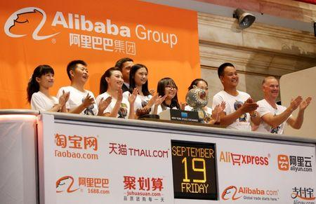 """Alibaba employees applaud as the opening bell of the New York Stock Exchange is rung, before the initial public offering (IPO) of Alibaba Group Holding Ltd under the ticker """"BABA"""" in New York"""