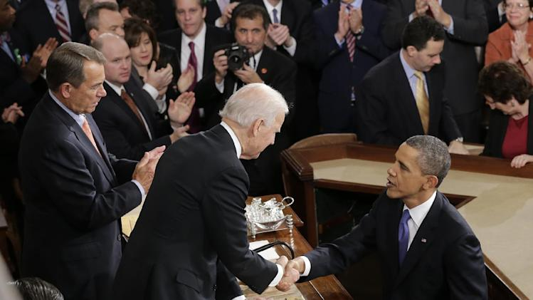 President Barack Obama shakes hands with Vice President Joe Biden after the president gave his State of the Union address during a joint session of Congress on Capitol Hill in Washington, Tuesday Feb. 12, 2013. House Speaker John Boehner of Ohio is at left. (AP Photo/J. Scott Applewhite)