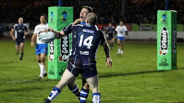 Ben Hellewell celebrates scoring the vital try at Workington