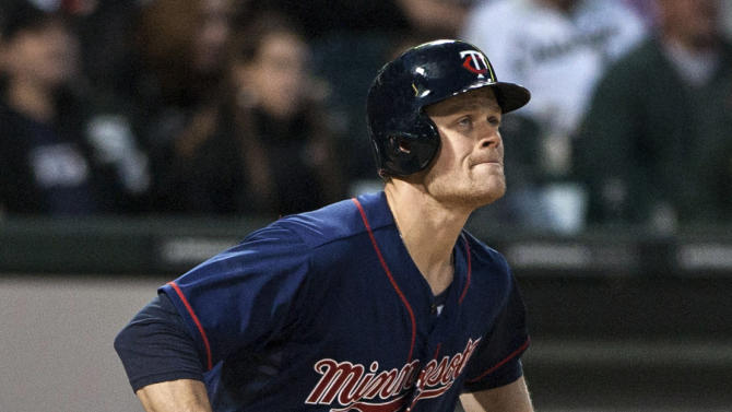 FILE - In this May 22, 2012, file photo, Minnesota Twins' Justin Morneau watches his three-run home run against the Chicago White Sox during the fourth inning in a baseball game in Chicago. Morneau has struggled since a concussion knocked him out for the 2010 season. Since coming off the disabled list a couple weeks ago, however, Morneau has connected for five home runs to jumpstart his numbers. (AP Photo/Charles Cherney, File)