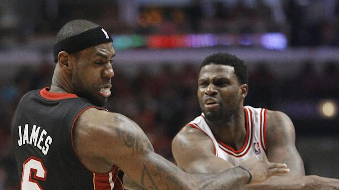 Chicago Bulls center Nazr Mohammed (48) pushes Miami Heat small forward LeBron James (6) to the floor during the first half of Game 3 of an NBA basketball playoffs Eastern Conference semifinal on Friday, May 10, 2013, in Chicago. Mohammed was ejected after this play.  (AP Photo/Charles Rex Arbogast)