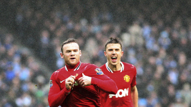 Manchester United's Wayne Rooney, left, celebrates his goal with Michael Carrick, right, during their FA Cup third round soccer match against Manchester City at the Etihad stadium, Manchester, England, Sunday, Jan. 8, 2012. (AP Photo/Scott Heppell)