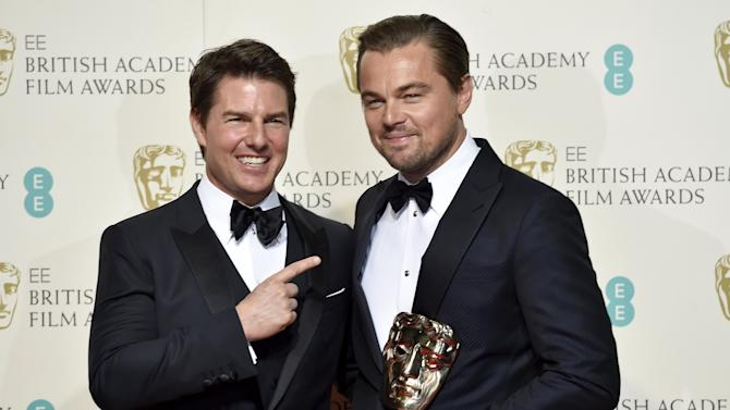 Leonardo DiCaprio holds his award for best leading actor as he stands with presenter Tom Cruise at the British Academy of Film and Television Arts (BAFTA) Awards at the Royal Opera House in London