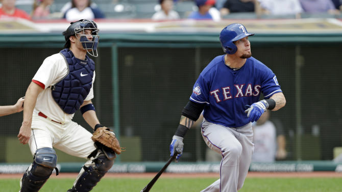 FILE - In this Dec. 2, 2012, file photo, Texas Rangers' Josh Hamilton watches his home run with Cleveland Indians catcher Lou Marson during a baseball game in Cleveland. Rangers general manager Jon Daniels said Thursday, Dec. 13, 2012, that Hamilton has agreed to a contract with the Los Angeles Angels. (AP Photo/Mark Duncan, File)