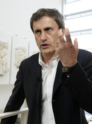 Rome mayor Gianni Alemanno gestures during a photo opportunity in Rome on May 21, 2013. Silvio Berlusconi's figure looms large over Rome's mayoral elections this weekend even though the former premier isn't among the 19 candidates running. The vote is very much a test of Berlusconi's enduring political influence and voter sentiment over the uneasy national government made up of his center-right forces and the center-left that was formed following inconclusive February elections. While local issues don't necessarily mirror national concerns, how Berlusconi's candidate, incumbent Mayor Gianni Alemanno, fares is being watching as a measure of his political weight amid his continuing legal woes: Berlusconi faces a ban from holding public office for five years if his recent tax fraud conviction is upheld on final appeal and a verdict is due soon in his sex-for-hire trial. (AP Photo/Andrew Medichini)
