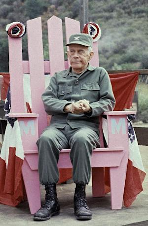 """FILE - In this Sept. 19, 1982 photo, Actor Harry Morgan sits on the set of  """"M*A*S*H*"""" in Los Angeles.   The Emmy-winning character actor whose portrayal of the fatherly Col. Potter on television's """"M*A*S*H"""" highlighted a show business career that included nine other TV series, 50 films and the Broadway stage, died Wednesday, Dec. 7, 2011. He was 96.  Morgan appeared in mostly supporting roles on the big screen, playing opposite such stars as Henry Fonda, John Wayne, James Garner, Elvis Presley and Dan Aykroyd. On television, he was more the comedic co-star, including roles on """"December Bride,"""" its spin-off """"Pete and Gladys,"""" as Sgt. Joe Friday's loyal partner in later """"Dragnet"""" episodes and on CBS-TV's long-running """"M-A-S-H"""" series, for which he earned an Emmy award in 1980.    (AP Photo/Wally Fong)"""
