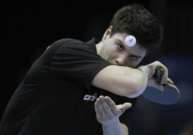 Germany's Dimitrij Ovtcharov serves to South Korea Ryu Seung Min during the men's singles last 16 table tennis match at the ITTF Pro Tour Grand Finals at ExCeL in London, Thursday, Nov. 24, 2011. ExCe