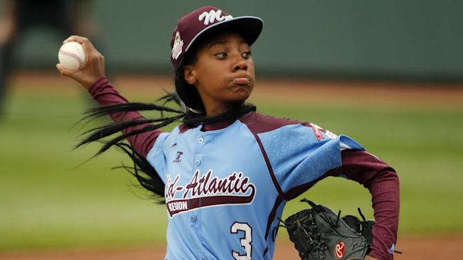 FILE - This Aug. 15, 2014 file photo, shows Pennsylvania's Mo'ne Davis delivering a pitch in the fifth inning against Tennessee during a baseball game in United States pool play at the Little League World Series tournament in South Williamsport, Pa. Pennsylvania won 4-0 with Davis pitching a complete game two-hit shutout. Americans are closing out 2014 on an optimistic note, according to a new Associated Press-Times Square Alliance poll. Nearly half predict that 2015 will be a better year for them than 2014 was, while only 1 in 10 think it will be worse. There's room for improvement: Americans give the year gone by a resounding 'meh.' (AP Photo/Gene J. Puskar, File)