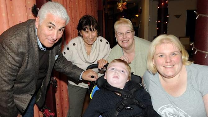 In this handout photo dated Wednesday, Nov. 30, 2011, and provided by The Amy Winehouse Foundation. Amy Winehouse's parents, Mitch Winehouse, left, and Janis Winehouse, second from left, visited Little Havens Children's Hospice in Essex, England where they met Callum Miller, bottom, his mother Jane Morgan, second from right and  Callum's grandmother Victoria Morgan, right, to meet the people benefiting from the foundations £10,000, euro 11,624, $15.695 grant. (AP Photo, The Amy Winehouse Foundation, HO) EDITORIAL USE ONLY