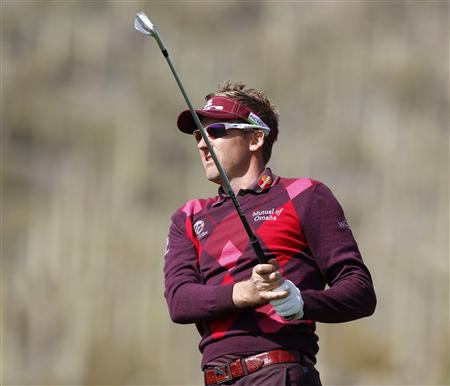 Poulter of England watches his second shot on the 17th hole during the second round of the WGC-Accenture Match Play Championship golf tournament in Marana