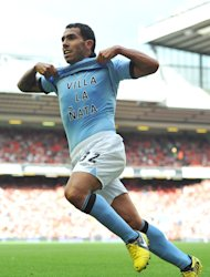 Roberto Mancini wants Carlos Tevez, pictured, to maintain his strong start