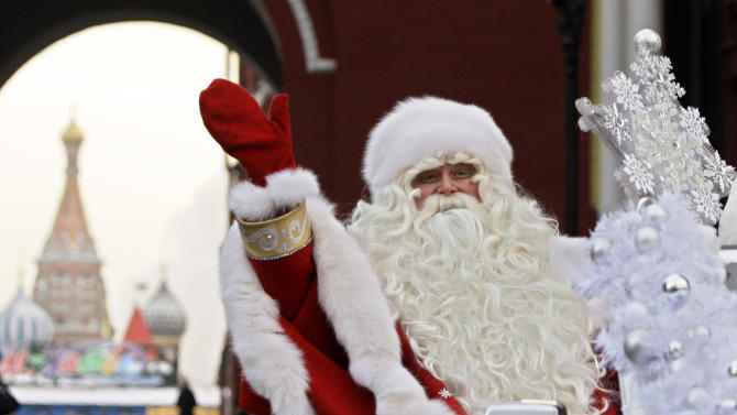 FILE - In this Friday, Dec. 26, 2008 file photo, Father Frost, the Russian equivalent to Santa Claus, waves during a welcome ceremony near Red Square, with St. Basil Cathedral in the background, in Moscow. The Central Asian nation of Uzbekistan is reportedly stealing Christmas by keeping the local version of Santa Claus off the airwaves. Independent news website UzMetronom reported Monday Dec. 10, 2012, that President Islam Karimov's authoritarian government imposed the informal ban on Father Frost and his snow maiden sidekick. (AP Photo/Sergey Ponomarev, file)