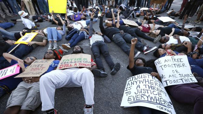 Protesters lie in an intersection during a demonstration, following the Tuesday grand jury decision in the shooting of Michael Brown in Ferguson, Missouri, in Los Angeles