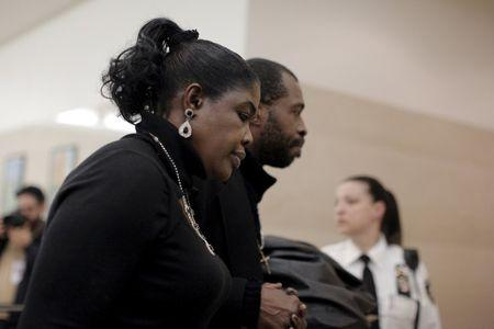 Sylvia Palmer, mother of Akai Gurley, is led from the court room at the Brooklyn Supreme court in the Brooklyn borough of New York