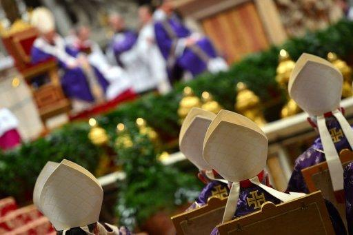 Cardinals look at Pope Benedict XVI during the Ash Wednesday Mass, marking the start of Lent on February 13, 2013