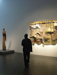 Sculptor El Anatsui at his exhibit in Denver, Colorado