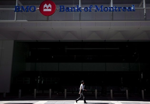 A person walks by the Bank of Montreal in Toronto on August 28, 2012. THE CANADIAN PRESS/Michelle Siu