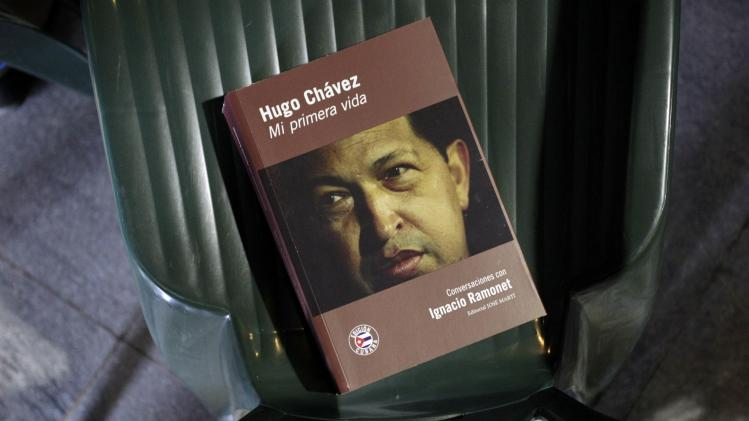 """Hugo Chavez, My First Life"" written by Ramonet is seen on a chair during the book's launch in Havana"