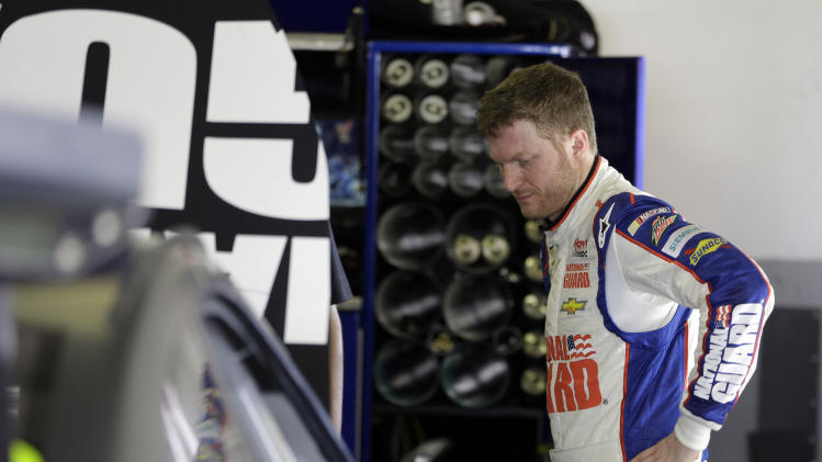 Dale Earnhardt Jr. stands by his car in his garage after he started a wreck involving a group of cars during NASCAR auto race testing at Daytona International Speedway, Friday, Jan. 11, 2013, in Daytona Beach, Fla. (AP Photo/John Raoux)