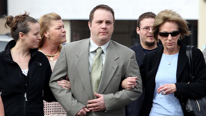 Former West, Texas, paramedic Bryce Reed, center, walks to Federal Court with relatives for his sentencing hearing Wednesday, Dec. 4, 2013, in Waco Texas. Reeds was sentenced to 21 months in prison after pleading guilty in a pipe bomb case that isn't linked to the West Fertilizer Co. explosion that killed 15 people last April in West, Texas. (AP Photo/Waco Tribune Herald, Jerry Larson)