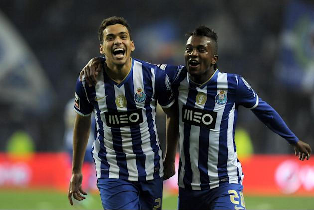 FC Porto's Carlos Eduardo, left, celebrates with Kelvin Oliveira, both from Brazil, after scoring his team third goal against Olhanense in a Portuguese League soccer match at the Dragao Stadium in