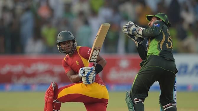 Zimbabwe batsman Chamu Chibhabha (left) is caught behind by Pakistani wicketkeeper Sarfraz Ahmed for 99 runs during the second one day international match between Pakistan and Zimbabwe at the Gaddafi Stadium in Lahore on May 29, 2015