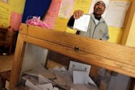 A local resident is seen casting his vote at a polling station in Mansura, 120 km north of Cairo, in March. An electoral coalition led by the Muslim Brotherhood has threatened to boycott November's legislative elections in Egypt if the electoral law is not amended