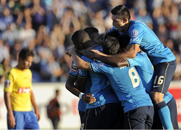 FC Porto's players celebrate after scoring the opening goal against Arouca during their Portuguese League soccer match at the Municipal Stadium, in Arouca, Portugal, Sunday Oct. 6, 2013