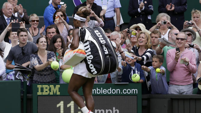 Serena Williams of the United States signs autographs for supporters after she lost to Sabine Lisicki of Germany in a Women's singles match at the All England Lawn Tennis Championships in Wimbledon, London, Monday, July 1, 2013. (AP Photo/Alastair Grant)