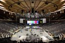 """Workers prepare Madison Square Garden for the """"12-12-12"""" concert whose proceeds will aid the victims of Superstorm Sandy, Tuesday, Dec. 11, 2012, in New York. The Dec. 12 concert will feature artists Bon Jovi, Eric Clapton, Dave Grohl, Billy Joel, Alicia Keys, Chris Martin, The Rolling Stones, Bruce Springsteen & the E Street Band, Eddie Vedder, Roger Waters, Kanye West, The Who and Paul McCartney. (AP Photo/John Minchillo)"""
