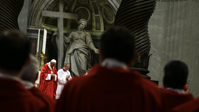 Pope Francis, left, celebrates a mass of Pentecost in St. Peter's Basilica, at the Vatican, Sunday, May 24, 2015. (AP Photo/Gregorio Borgia)