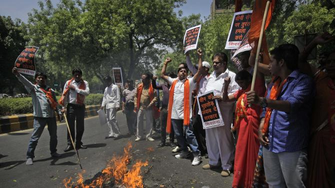 Indian protestors of right wing Shiv Sena party burn an effigy and shout slogans against the alleged incursion by Chinese troops into Indian territory, during a protest in New Delhi, India, Wednesday, May 1, 2013. India says Chinese troops crossed the de facto border between the countries and went 10 kilometers (six miles) into Indian territory on April 15. About 50 Chinese soldiers are camping in tents Kashmir's Ladakh region.  (AP Photo /Manish Swarup)