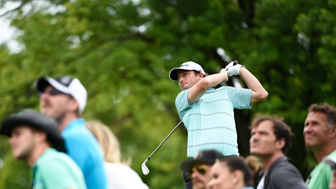 Tim Clark of South Africa tees off on the 13th tee during the final round of the RBC Canadian Open at the Royal Montreal Golf Club on July 27, 2014 in Montreal, Quebec, Canada