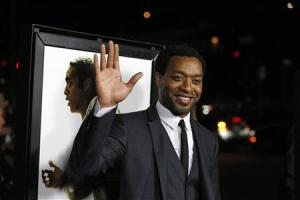 "Cast member Ejiofor waves at a special screening of ""12 Years a Slave"" at the Directors Guild of America in Los Angeles"