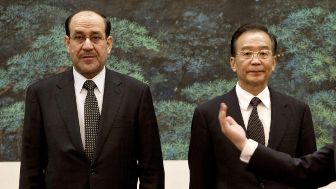 Iraqi Prime Minister Nouri al-Maliki, left, stands next to Chinese Premier Wen Jiabao before their signing ceremony at the Great Hall of the People in Beijing, China, Monday, July 18, 2011. (AP Photo/Andy Wong, Pool)