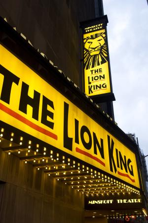 """FILE - In this Jan. 19, 2012 file photo,""""The Lion King"""" marquee is displayed at The Minskoff Theatre are seen in New York. A nonprofit group is planning two autism-friendly performances of Broadway's """"The Lion King"""" and """"Mary Poppins"""" for families with children diagnosed with the disorder. The Theatre Development Fund, an organization focused on providing access to live theater, announced Tuesday its plan to offer specially designed matinee showings of """"Mary Poppins"""" on April 29 and """"The Lion King"""" on Sept. 30. (AP Photo/Charles Sykes, file)"""